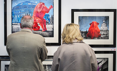 Visitors browsing art at Battersea fair