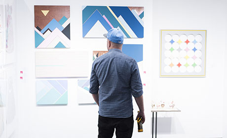 Man browsing art at New York fair