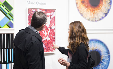 Visitors browsing art at New York Spring fair