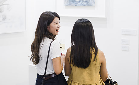 Women browsing art at Hong Kong fair