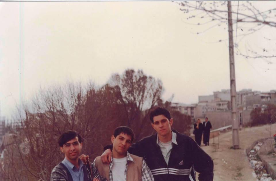 Ebi (far right) with his friends in Tehran in 1998